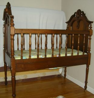 antique baby crib on popscreen
