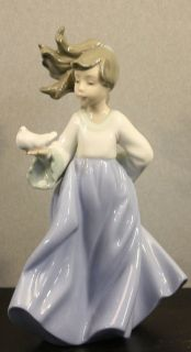 NAO BY LLADRO PORCELAIN FIGURINE (WINGED FRIEND)