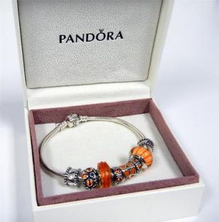 Authentic Pandora Sterling Silver Bracelet with 4 Charms and 2 Spacers