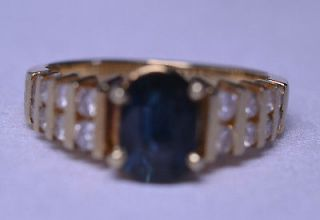 14K YELLOW GOLD OVAL SAPPHIRE AND DIAMOND RING   1.5 CARATS TW   SIZE