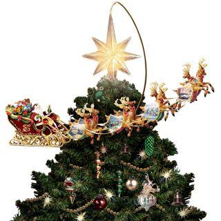 The Thomas Kinkade Revolving Christmas Tree Topper   Hammacher