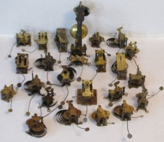 Lot of 25 Antique Brass Clock Alarm Movements