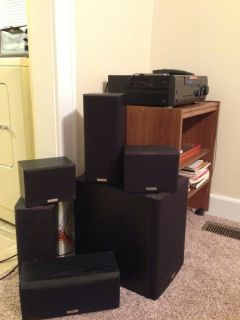 Surround sound system includes subwoofer, AV surround receiver, and