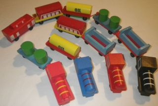 13 wooden toy trains with working wheels ages 2 by Anthony Williams GC
