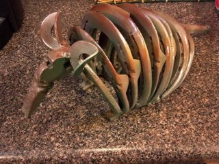 ARMADILLO made from scrap metal and horseshoes.