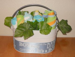 this adorable baby boy flower basket contains 3 burpcloths and
