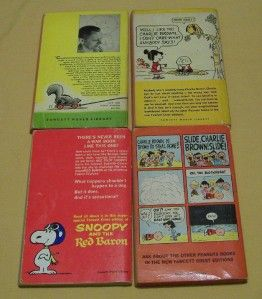 Lot of 4 Peanuts / Charlie Brown Books. Softbound paperbacks.