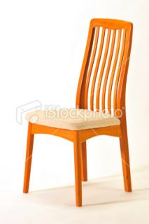 Contemporary teak dining room chair Royalty Free Stock Photo