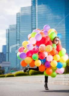 stock photo 12742637 woman holding many balloons