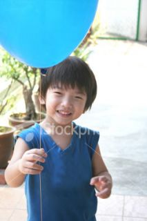 Little boy holding balloon  Stock Photo  iStock