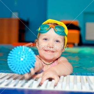 Child in a swimming pool Royalty Free Stock Photo