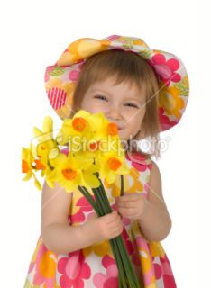 Cute little girl giving yellow flowers  Stock Photo  iStock