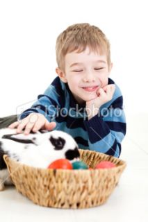 stock photo 16159170 cute little boy and easter bunny