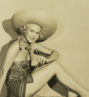 Photograph Risque Joan Blondell Pin Up Cowgirl Hay Bale Legs