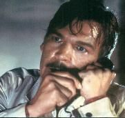 Tom Atkins as Dan Challis in the last scene of Halloween III .