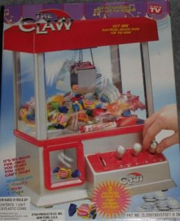 New The Claw Electronic Candy Toy Machine Arcade Game with Music as