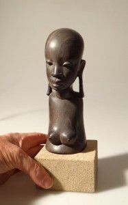 african ebony carved portrait topless tribal girl