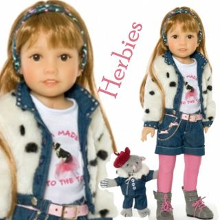 Gallina wears a rhinestone trimmed taux aur jacket with lining, a