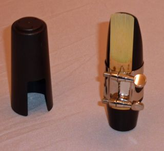 generic alto sax mouthpiece with ligature and cap this is a generic