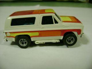 Aurora AFX Magna Traction White Red Orange Yellow Lighted Chevy Blazer