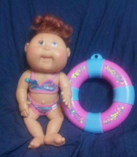 Cabbage Patch doll hard body can be put in water green eyes and