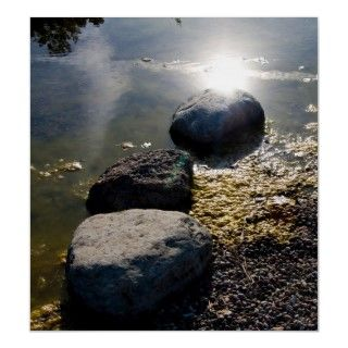 Three stones and the sun in water.