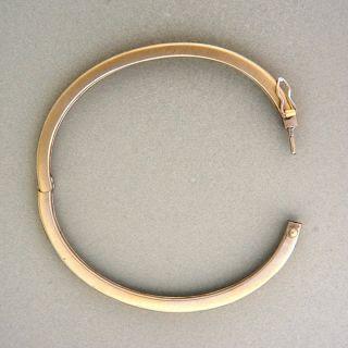 Solid 18k white gold hinged bangle bracelet. Brush finish and nice