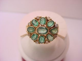 18KT YELLOW GOLD OVAL CUT EMERALDS AND ROSE CUT DIAMONDS RING