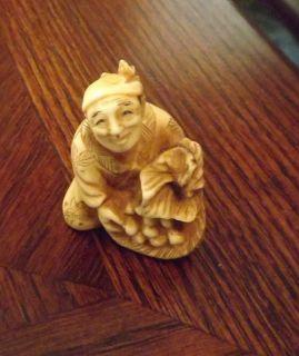 Japanese Netsuke Faux Ivory Ox Bone Man with A Basket of Fruit Signed