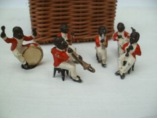 A Collection of Antique Black Band Musicians Figures Toys Cake Decorations