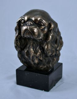 King Charles Spaniel on marble statue figurine sculpture head Cold