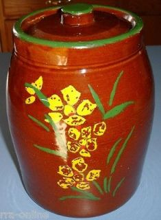 Vintage pottery cookie jar with cold painted flowers