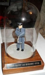 WORLDS GREATEST LAW ENFORCEMENT OFFICER FIGURE POLICE IN GLASS CASE