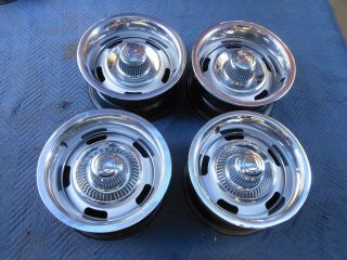 RALLY WHEEL SET OF 15X7 AG CODE ORIGINAL GM WHEELS RINGS AND CAPS
